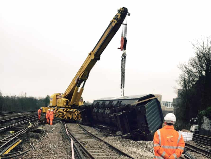 Heavy machinery righting the derailed freight train in Lewisham.