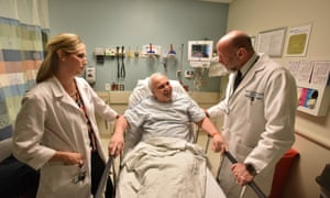 Dr Mark S Rosenberg and Dr Alexis LaPietra talk to a patient in the emergency room at St Joseph's regional medical center in Paterson, New Jersey.
