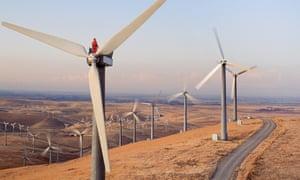 Man standing on wind turbine