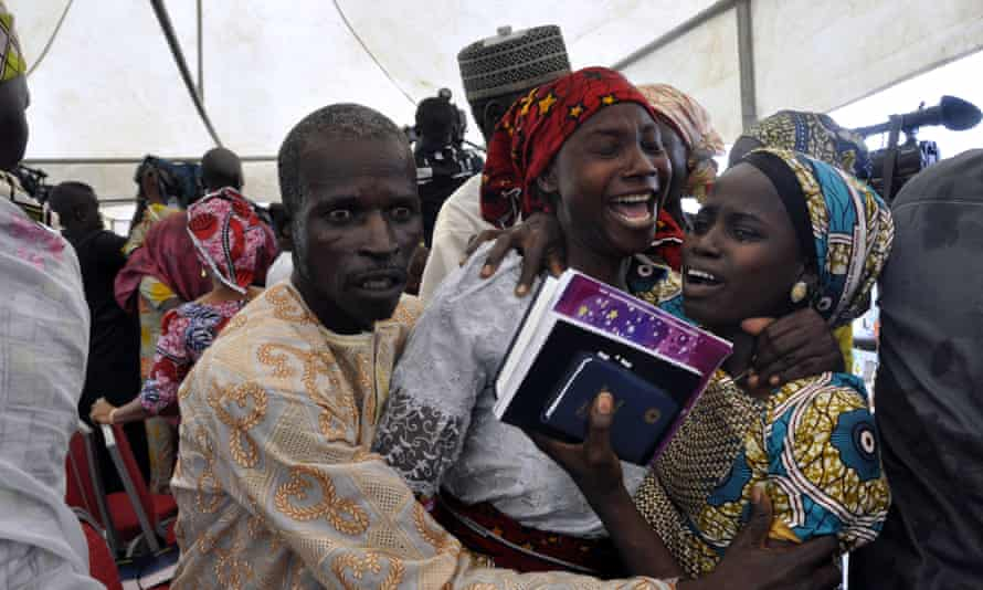 One of the girls released in October 2016 celebrates with family members in Abuja;