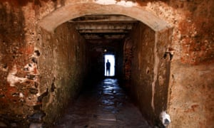 A man is silhouetted against the 'Door of No Return' at the House of Slaves on Goree Island near Senegal's capital, Dakar.