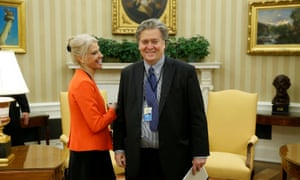 Kellyanne Conway and Steve Bannon share a lighter moment in the Oval Office.