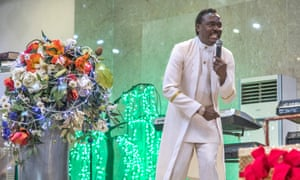 Okotie leads the 'praise and worship' session of his Sunday service.