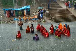 Hindu devotees stand in the Buriganga River as they observe the Chhath Puja festival in Dhaka, Bangladesh