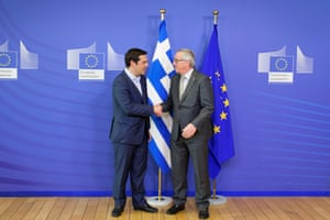 03 Jun 2015, Brussels, Belgium --- Brussels, Belgium. 3rd June 2015 -- Prime Minister of Greece Alexis Tsipras shakes hands with European Union Commission President Jean-Claude Juncker at the European Union Commission headquarters in Brussels. -- Prime Minister of Greece Alexis Tsipras met with the European Union Commission President Jean-Claude Juncker at the European Union Commission headquarters in Brussels. --- Image by © olivier Gouallec/Demotix/Corbis