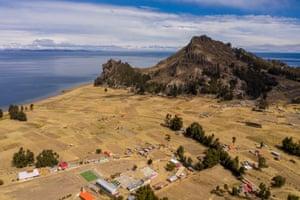 Santiago de Okola, beneath the Sleeping Dragon rock formation, on the shore of Lake Titicaca.