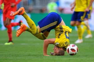 Sweden's forward Ola Toivonen takes a tumble as they chase the game.