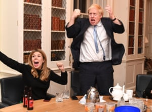 Boris Johnson and his partner Carrie Symonds in a shot taken on election night by his personal snapper Andrew Parsons, jokingly known by envious colleagues as 'the court photographer'