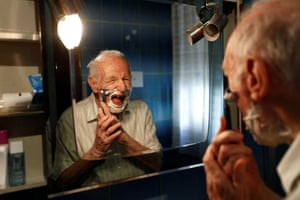 Palermo, Italy: Giuseppe Paterno shaves at home before his graduation from the University of Palermo with an undergraduate degree in history and philosophy. At 96, his is Italy's oldest student
