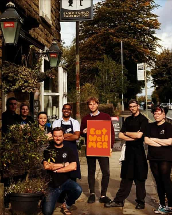 Duckett (kneeling) and staff outside the pub after joining Eat Well Manchester.