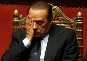 December 2010: Berlusconi attends a session at the senate in Rome. His slim victory in a close parliamentary confidence vote led to riots in Rome