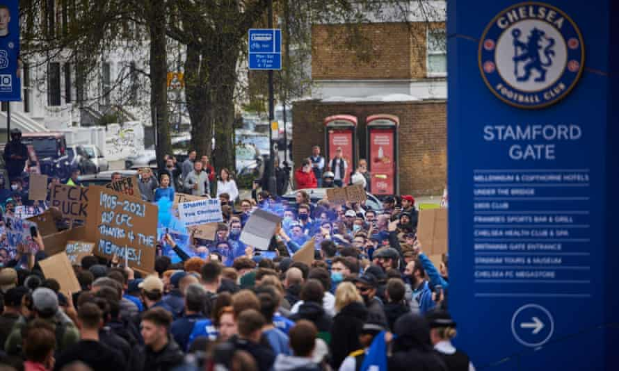 Chelsea fans protest outside Stamford Bridge before the scheduled game with Brighton against the club's involvement in the European Super League.