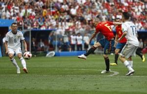 Iniesta shoots.