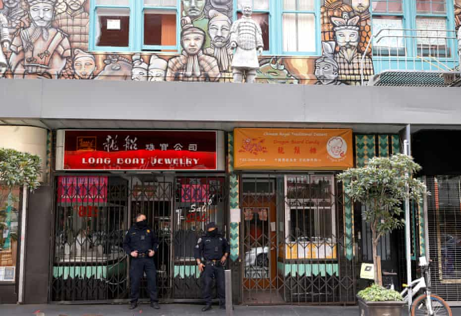 Officers patrol in San Francisco's Chinatown.