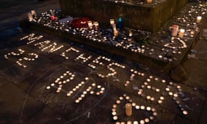 Memorial candles at a vigil for the victims of the Manchester Arena bombing in St Ann's Square, Manchester, on Monday night.