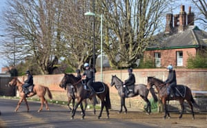 Horses head out to the gallops at Newmarket racecourse on Tuesday.