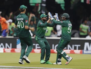 Imam celebrates with teammate and captain Sarfaraz after taking a catch to dismiss De Kock for 47.