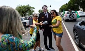 Supporters Jair Bolsonaro pose for picture in Brasilia on Saturday.
