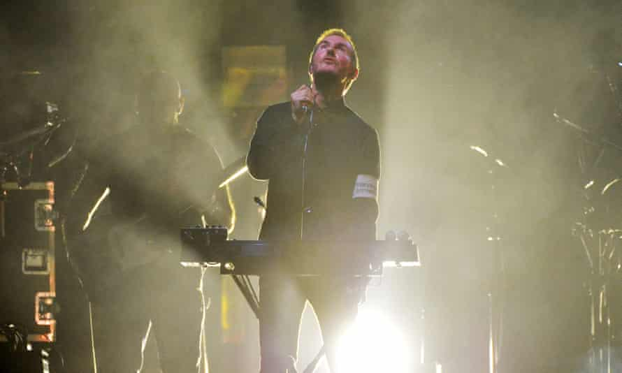 Robert Del Naja, aka 3D, of Massive Attack performs live on stage during the band's last tour at the O2 arena.