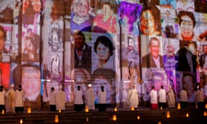 Pictures of Covid-19 victims projected on the Lima cathedral during a candlelight open-air mass in November 2020.