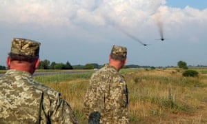 Ukrainian soldiers watch frontline bombers during military drills in the Rivne region