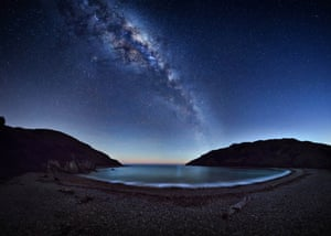 Cable BayMark Gee (Australia). The magnificent Milky Way stretches across the night sky reflecting on Cable Bay near Nelson, New Zealand. The photographer had to take the picture before the light washed out the sky. 42 individual images were stitched in to a large multi row panorama to create this image.