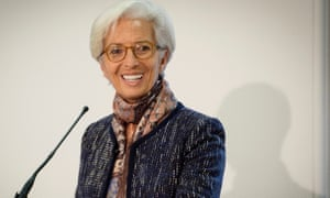 Christine Lagarde smiles as she speaks at the Treasury in London