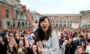 'Yes' campaigners celebrate the official result of the Irish abortion referendum at Dublin Castle in Dublin on May 26, 2018.