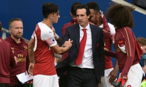 Özil and Unai Emery shake hands after the final whistle