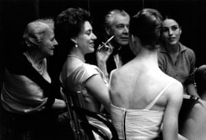 Princess Margaret at a party on stage at the Royal Opera House, with ballerinas Georgina Parkinson (facing camera) and Antoinette Sibley (back to camera), 1960s