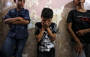Young friends and relatives at the funeral of Palestinian Omar Hassan Abu al-Nile, 12