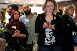 A woman wears a shirt with a likeness of Ginsburg as she checks returns at an election night party for Democrats on 6 November.