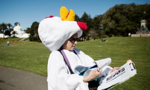Carol Misseldine wearing a chicken suit, collecting signatures for the farm animal legislation.
