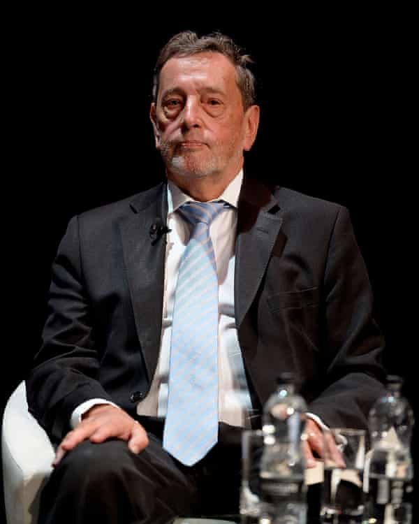 Lord Blunkett seated on stage during an event