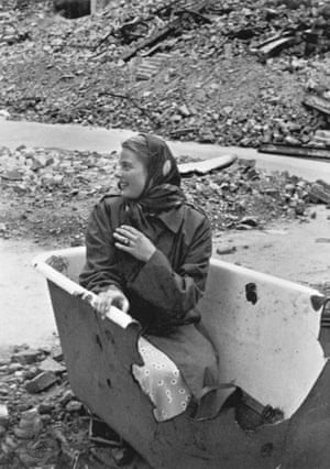 'I met [Robert] Capa again in Berlin. He found a bathtub in the street. He said this was going to be his scoop: for the first time, Ingrid Bergman photographed in a bathtub.' Capa's negatives were damaged and only one photo from this scene (taken by Carl Goodwin) has survived. Berlin, 1945