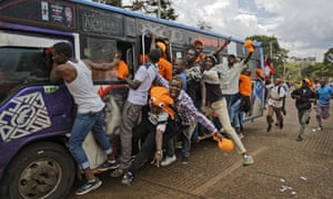 Supporters of opposition leader Raila Odinga ride on the outside of a 'matatu' minibus as they arrive for a rally in Uhuru Park in downtown Nairobi, which was later cancelled.