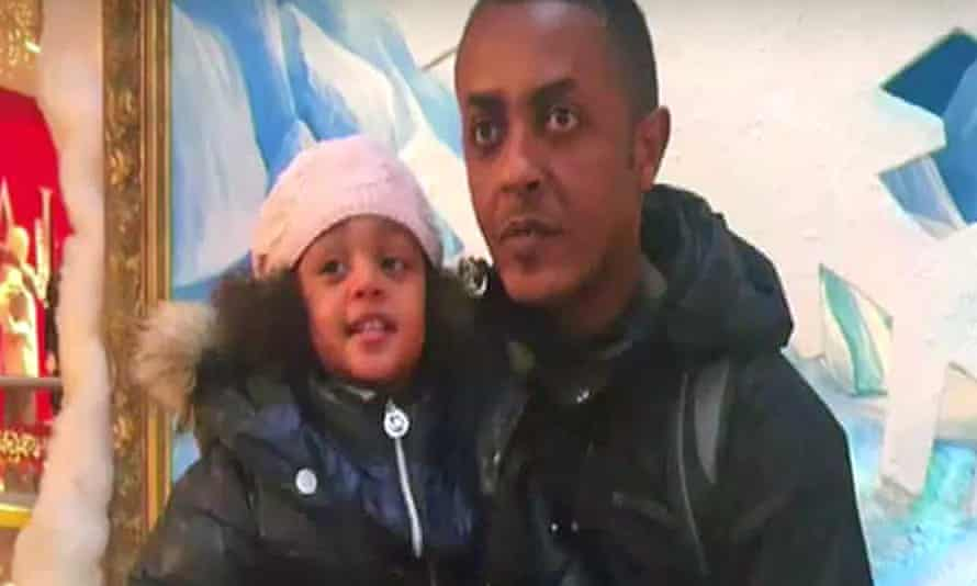 Mohamednur Tuccu with and his three-year-old daughter Amaya