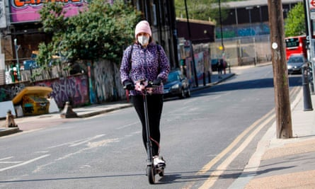 woman on e-scooter in London