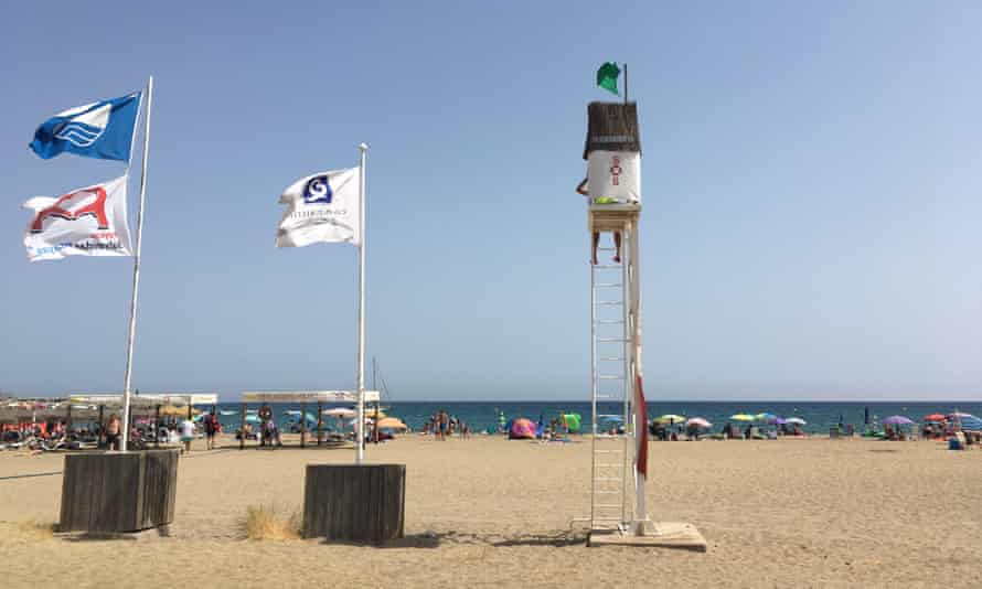 A quiet day for the lifeguard; a sparsely populated beach, at lunchtime, at San José, Almeria, Spain.