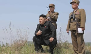 North Korean leader Kim Jong-un oversees a rocket-launching drill in 2014
