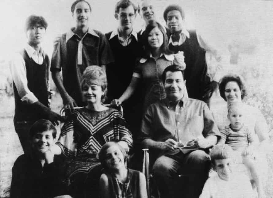 Jim Jones and his wife Marceline Jones, seated in front of their adopted children and next to his sister-in-law (right) with her three children, California, 1976.