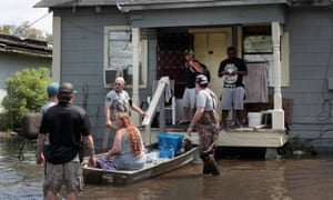 Members of the Wounded Veterans of Oklahoma help rescue flood victims.