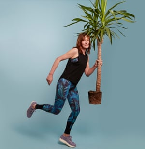 Zoe Williams running holding plant