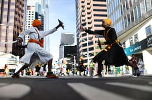 Young Sikhs practice traditional Indian martial arts during their annual parade marking Baisakhi