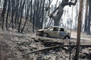 A burned car at N236 road between Figueiro dos Vinhos and Castanheira de Pera, Pedrogao Grande