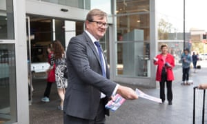 Tim Murray, Labor's candidate for Wentworth, hands out flyers at Bondi Junction train station.