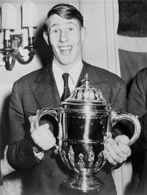 """Bannister holding his Sporting Record Trophy, which was presented to him in London at ceremonies in which he was named """"Sportsman of the Year."""""""