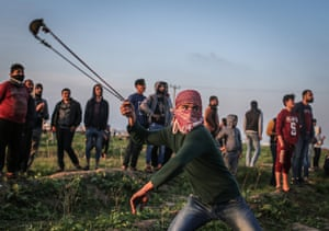 Palestinian protesters throw stones in response to Israeli security forces' intervention during a protest against the US decision to recognise Jerusalem as Israel's capital.