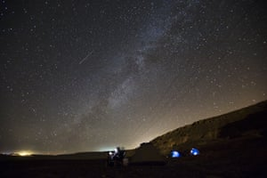<strong>Mitzpe Ramon, Israel</strong> A meteor streaks across the sky in the early morning as people watch the Perseid meteor shower in Ramon Crater