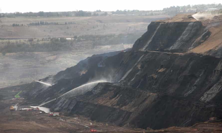 Firefighters battling a blaze at the Hazelwood open cut coal mine near Morwell, Victoria in 2014